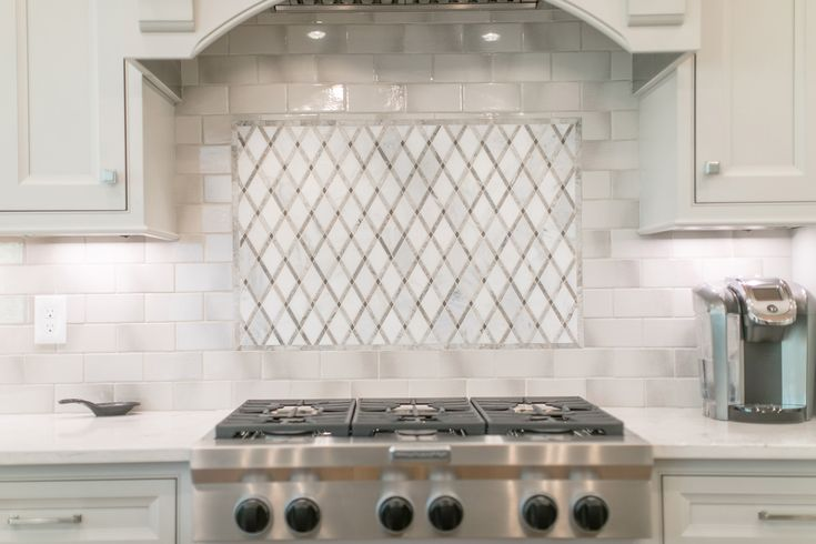 128 best our work toulmin cabinetry images on pinterest - Ideas for backsplash behind stove ...