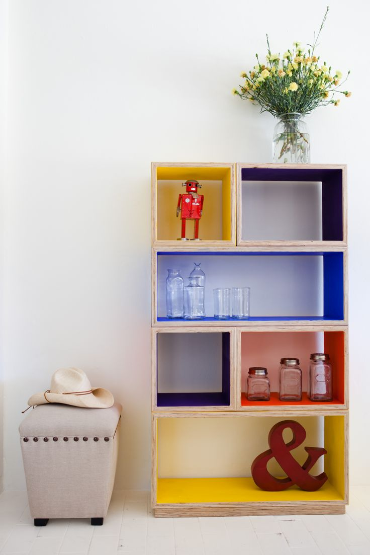 Modular plywood shelving, boxes can be moved around to create new structure, used as side tables and more.  Love the POP of colour we have made these over and over again in white and are about to make two large installations for a Camp Quality House.
