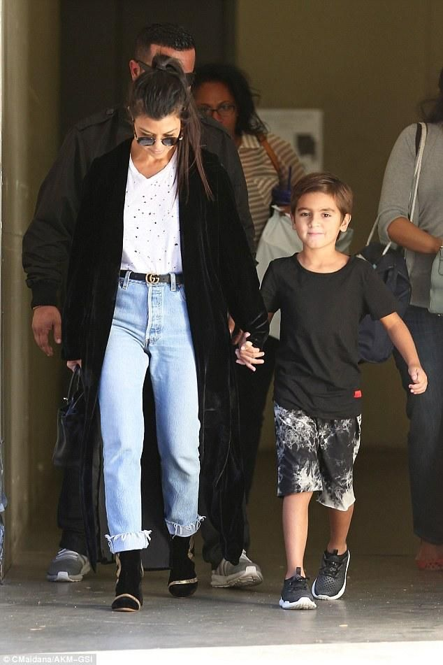 Mason Disick wearing Adidas Originals Tubular Radial Boys Grade School