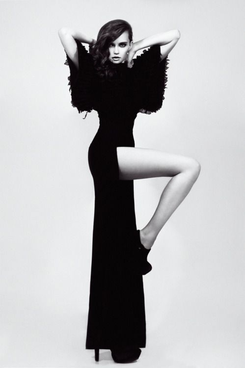 Great length pose, black and white, studio shoot. Amazing model concept for the dress.