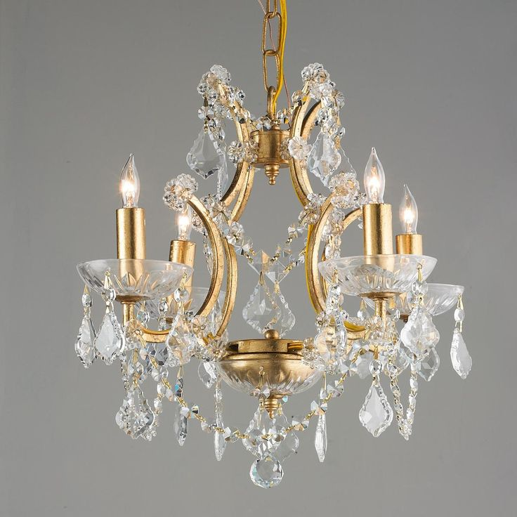 """Gold Leaf Add more than a little glitter with this gold leaf and crystal 4 light mini chandelier. From a glamorous bedroom to a dressy powder room, this little gem makes its mark. 4x60 watts (candle sockets) if used without shades. (13""""Hx18""""W)"""