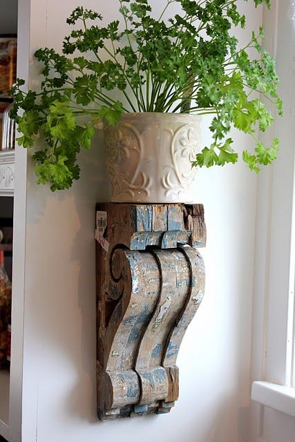 Wood corbels to hold potted herbs.