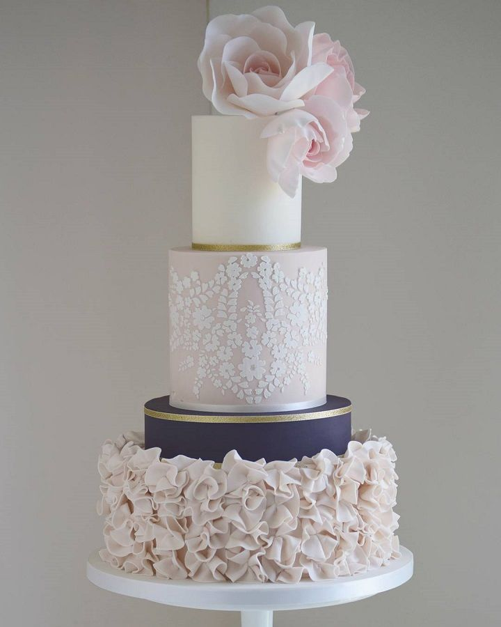 Beautiful blush and navy blue wedding cake with roses