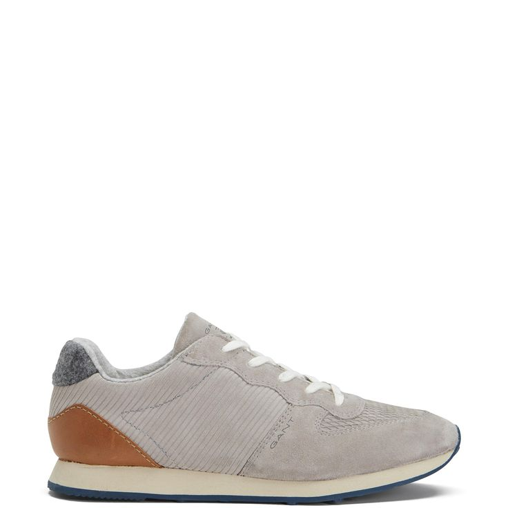 """Our Campus Sneaker, in silky cow suede, is designed for the sporty, sophisticated woman. Features a laced front with a perforated pattern on the upper, a 3D rubber printed GANT logo on the quarter panel, a soft textile lining with a natural leather insole and a lightweight EVA rubber outsole. (Style side note: """"EVA"""" refers to Ethylene Vinyl Acetate, an ultra shock-absorbent material that adds comfort to the wearer.)"""