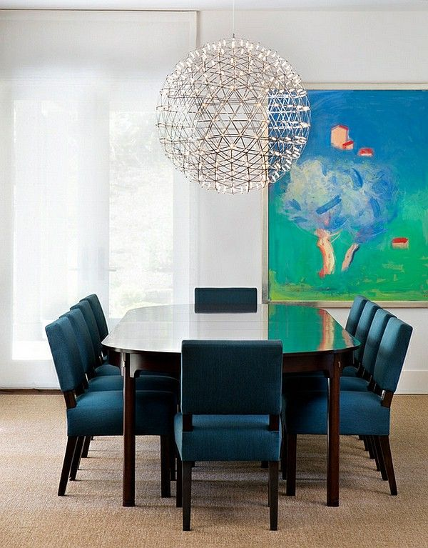 Transitional style blue chairs pendant lights In the dining room