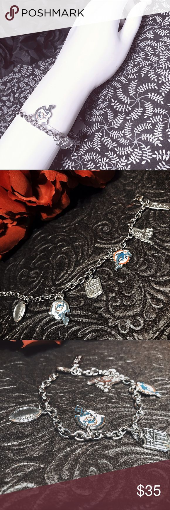 🛍 Silver plated Miami Dolphins dangle bracelet Super cute bracelet give to me years ago as a present. Put it away, and forgot about it, it's never been worn. It's very cute, small/dainty and very light. Will fit most wrists. #miamidolphins #dolphins #nfl #football #dolphan #footballsunday #miAmi #tannehill #wake #suh #danmarino #fins #silver #jewelry #bracelet #dangle Jewelry Bracelets