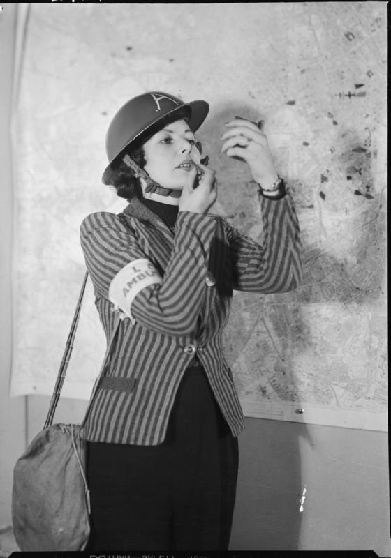 A female member of Air Raid Precautions staff applies her lipstick between emergency calls.