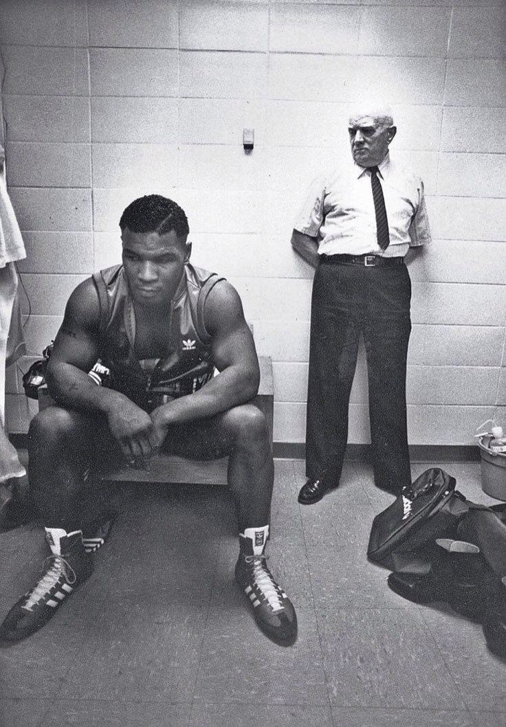 Mike Tyson and his trainer Cus D'amato before his first professional fight, 1985 By N@ruto Kaari$