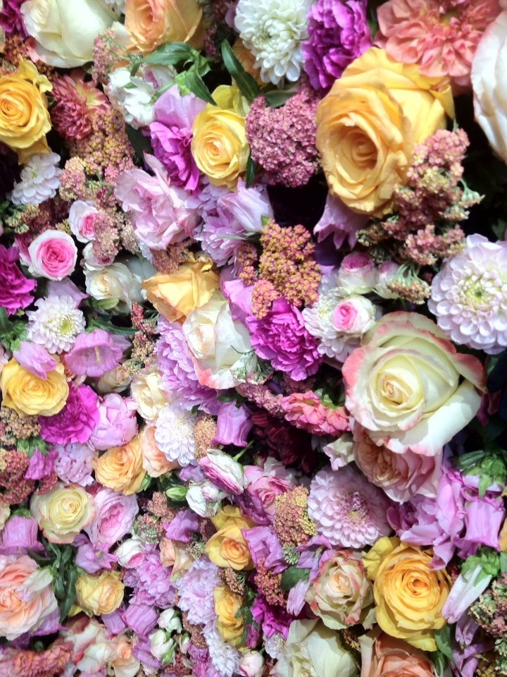 A close up of the DIOR flower wall.