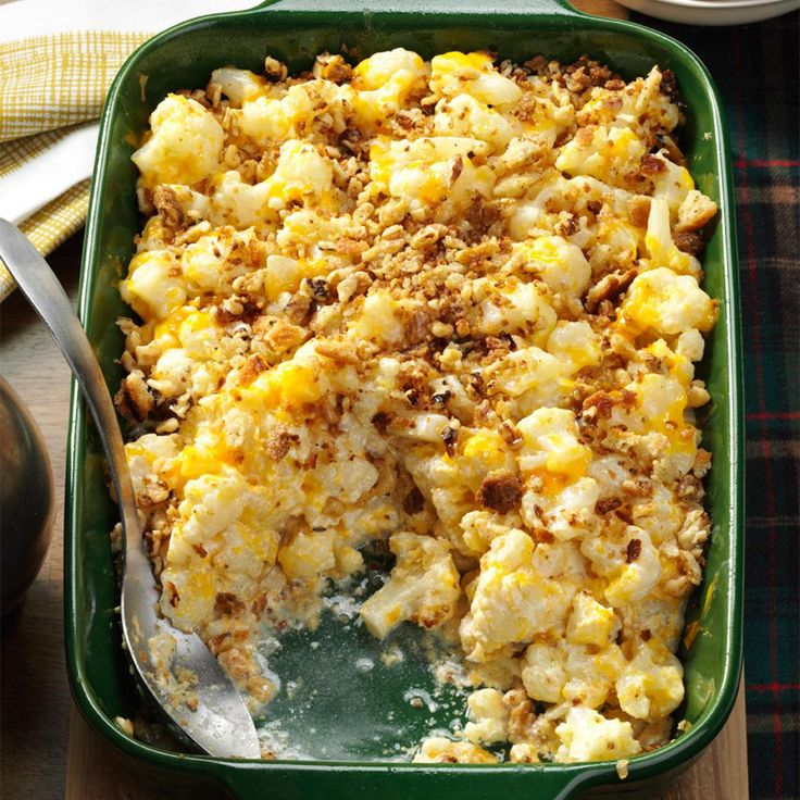 Christmas Cauliflower Casserole Recipe -This creamy casserole is filled with tender cauliflower and topped with a sprinkling of crispy herb stuffing. This holiday classic appeals to both kids and adults. —Carol Rex, Ocala, Florida