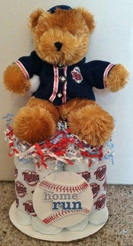 MINI DIAPER CAKES ARE THE PERFECTLY PRICED SHOWER GIFT!  Score a home run  with this adorable Minnesota Twins baseball cake.  Ingredients include:  10 size 1 (8-14lb) Pampers disposable diapers 1 Trav