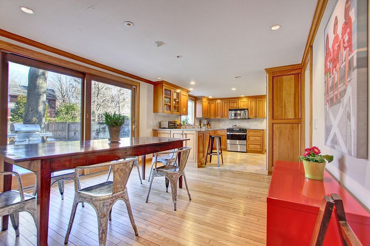 Modern industrial design in an eat-in kitchen. Inside 700 Mill Plain Road, Fairfield CT: Denise Walsh & Partners Real Estate: http://walshandpartners.com/700millplain