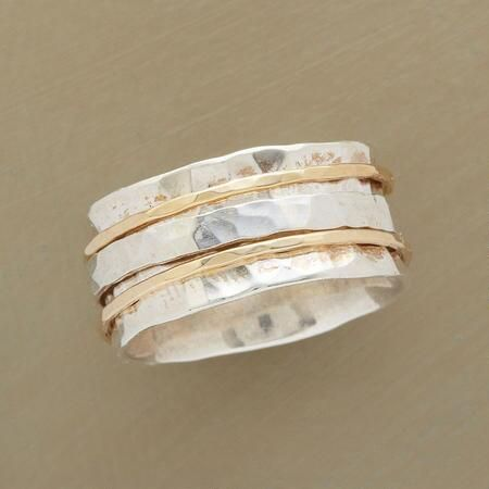 Perfect Partners.  $398.  Hand-Hammered Silver & Gold Spinner Ring                                              | Robert Redford's Sundance Catalog