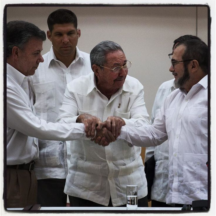 Cuban President Raul Castro encourages Colombian President Juan Manuel Santos (l) and Farc commander Timochenko (r) to shake hands in Havana Cuba. The peace is coming in our continent. Historic moment !!!!! Photo by Eliana Aponte for the news paper El Tiempo @eltiempo by eliaponte