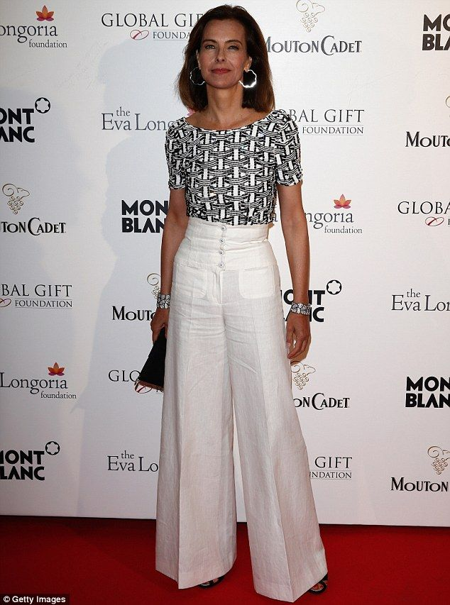 Sophisticated: French actress and model Carole Bouquet attended in a funky black and white...
