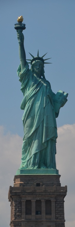 The Statue of Liberty in Upper New York Bay on Liberty Island, New York • designer: Frédéric Bartholdi • photo: Teagan Kahla on Living Life Today