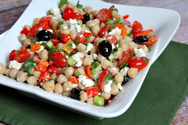 Mediterranean Chickpea Salad Recipe Salads with chickpeas, flat leaf parsley, chopped bell pepper, grape tomatoes, green onions, kalamata, feta cheese crumbles, extra-virgin olive oil, plain yogurt, lemon juice, red wine vinegar, garlic cloves, cumin, salt, pepper