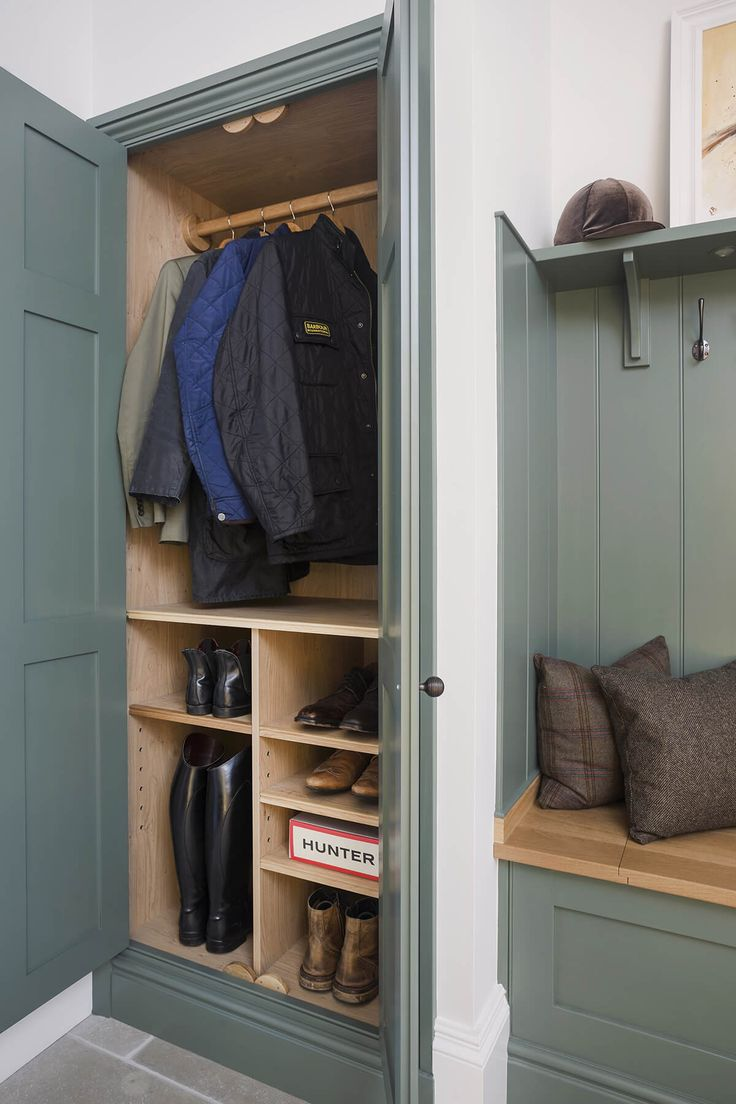 wardrobe and shelves either side of a bench seat a must in a functional mudroom must store shoes hats and jackets
