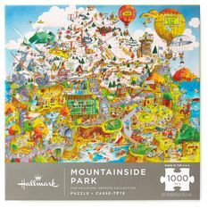 """When Robert Blair Martin retired from Hallmark, the 23 puzzles he had illustrated made him Hallmark's """"puzzle king."""" Of all his work, he most enjoyed creating lavishly detailed cartoons like this mountainside city scene that was first offered in 1979."""