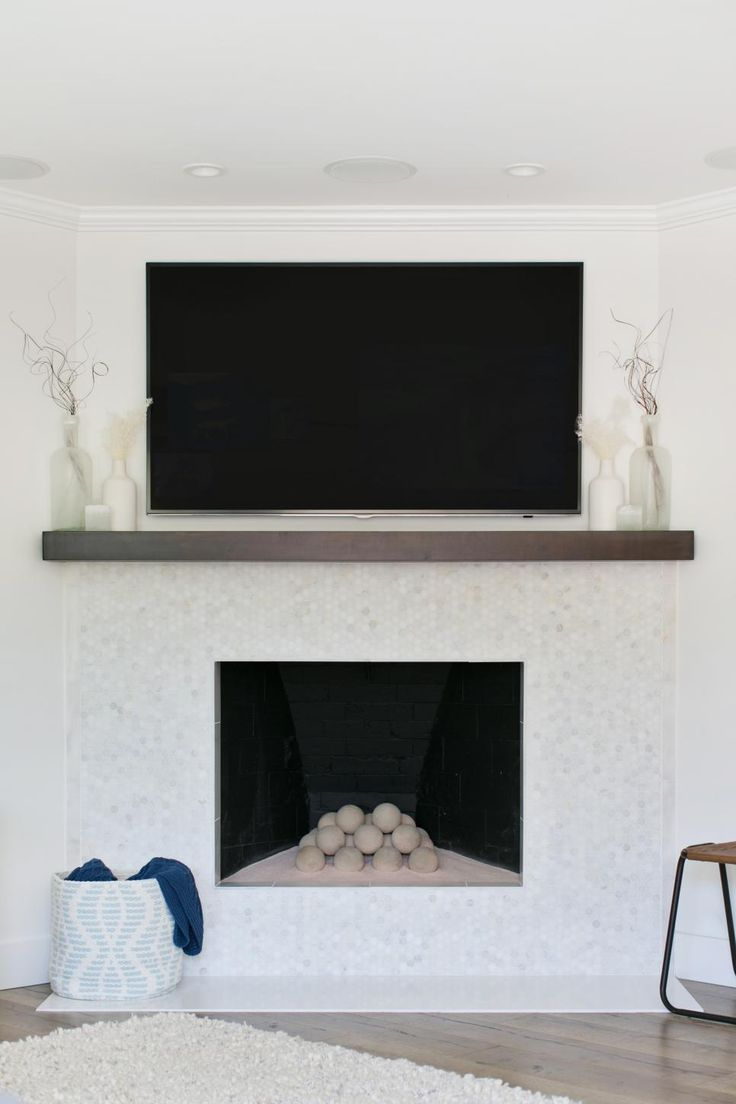 Your home improvements refference mosaic tile fireplace surround - White Mosaic Tiles Add Depth And Dimension Around The Fireplace A Pretty Graphic Pattern Basket