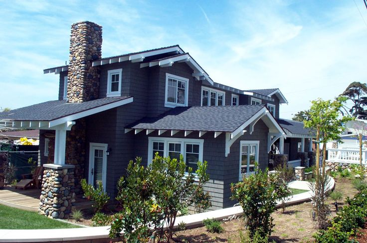 Navy blue house with white trim atone accents for Blue house builders