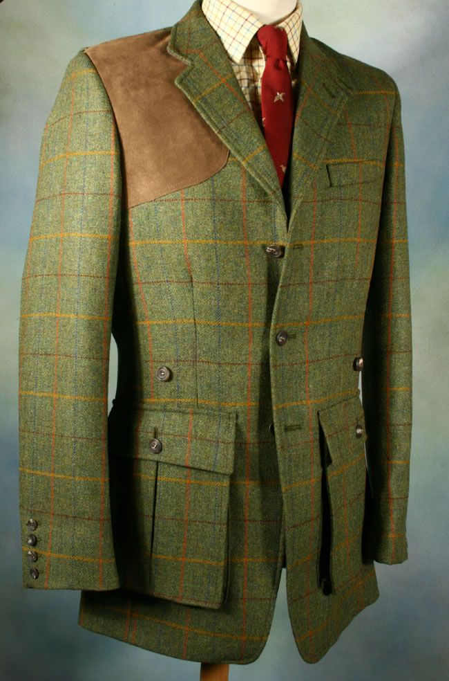 A besoke Norfolk shooting jacket, cut in English tweed, featuring all the correct features of a traditional sporting jacket. note the hunter-tab collar, the bellows pockets for fresh and spent shot (with buttons above to keep the pockets open for ease of access), and the suede padded shoulder to cushion the impact from discharging firearms.