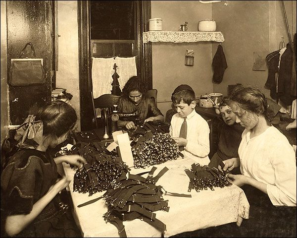 Lewis Hine photo of a Jewish family in New York working on garters in the kitchen of a tenement home.