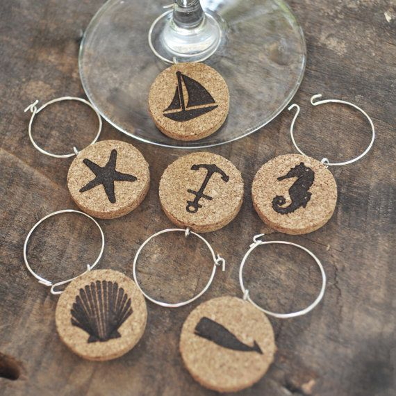 **FREE SHIPPING TO THE US!**  Sick of those metal wine charms that bang on your delicate wine and drinking glasses when you take a sip? Worry no more.  Our nautical wine glass charm set ensures that you can safely (and quietly) differentiate your glasses in style. The set features six cork nautical themed wine charms -- which measure 1-inch across -- with metal clasps. The cork lets you enjoy your drink without worrying about the charms moving around and damaging your glass. Each charm has a…