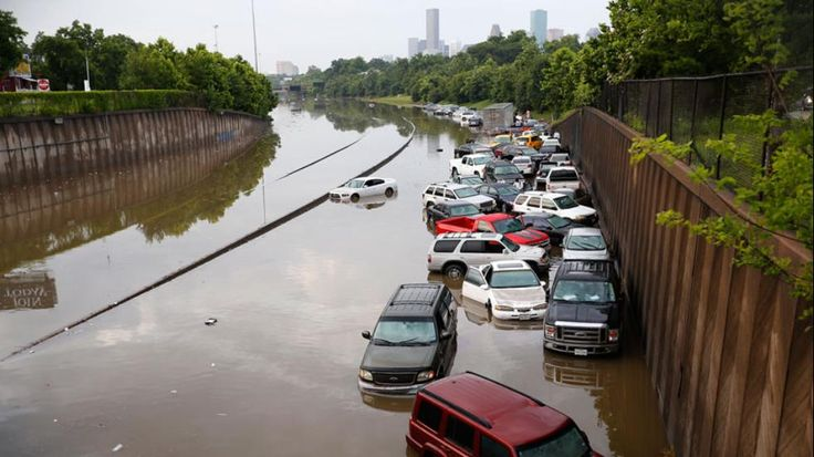 Houston Flood Nightmare  Cars piled up like toys along the side of I-45. May 2015