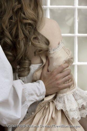 Trevillion Images - romantic-historical-couple-embracing: