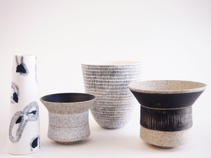 Monochrome palette with porcelain and stoneware with inlay decoration.
