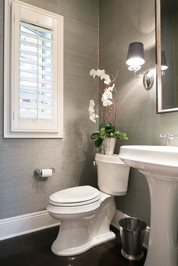 Grasscloth walls Interior Designer Cindi Borchard featured Glam Grass 5217  Geneva Grey in the powder room of a client's home.