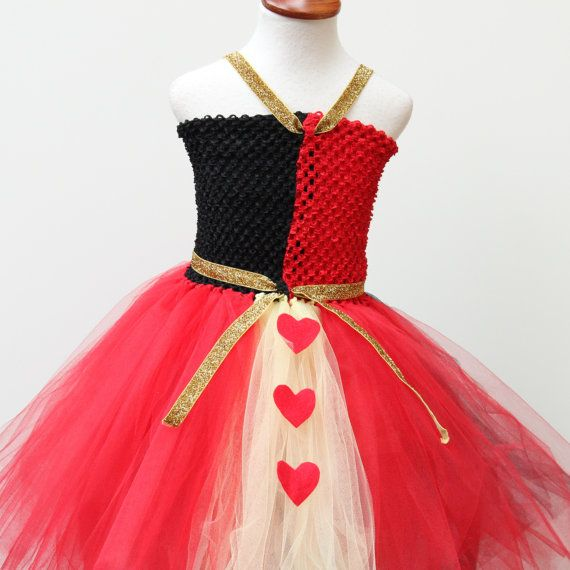 A dazzling Red Black dress inspired by Queen of Hearts from Alice in wonderland. Heart appliques on the skirt. The dress is made with a custom made