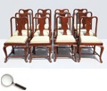 A set of twelve Queen Anne-style rosewood dining chairs, with curvaceous vase-shaped back splat and cabriole legs. This piece is from Western India.     20 in L x 21 in B x 36 in H