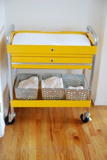 tool cart as changing table...love the color..but always end up using the floor when babysitting..maybe I'll use a changing table with my own kid?