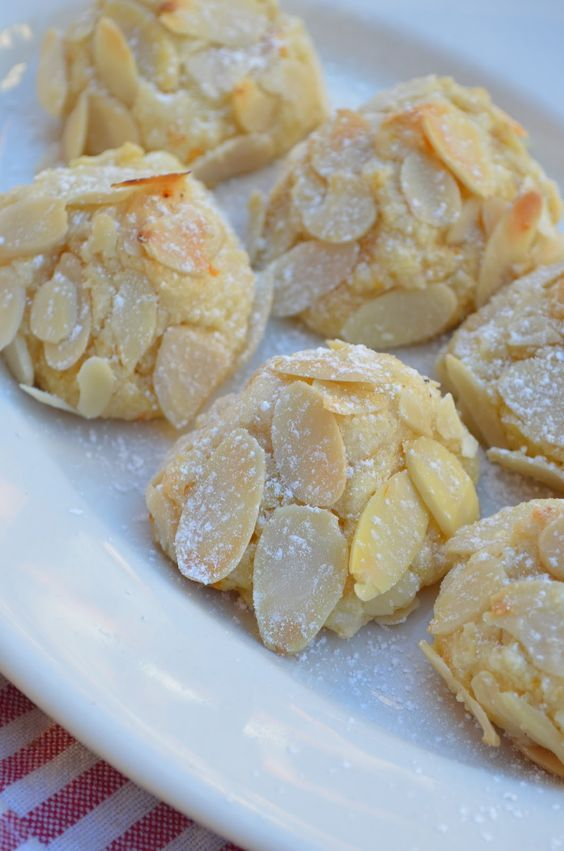 Almond Cookies Recipe: almond meal, superfine sugar, egg whites, orange zest, almond extract, sliced almonds and powdered sugar.