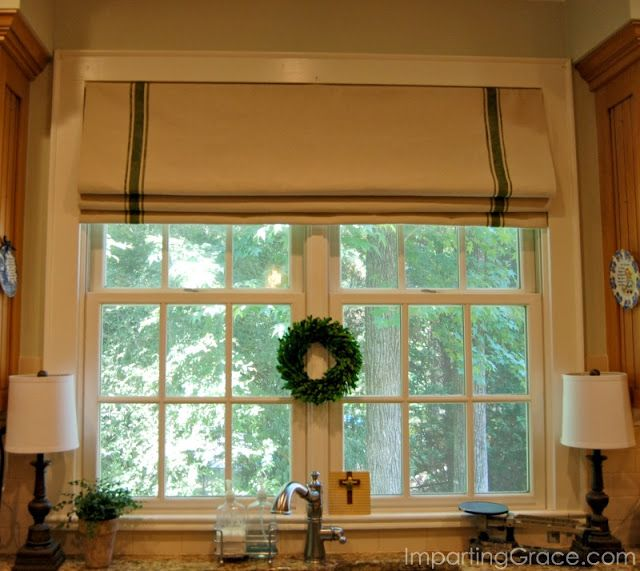 Add farmhouse style to a window by creating an inexpensive faux Roman shade--made from a dropcloth and craft paint! Complete tutorial at ImpartingGrace.com.