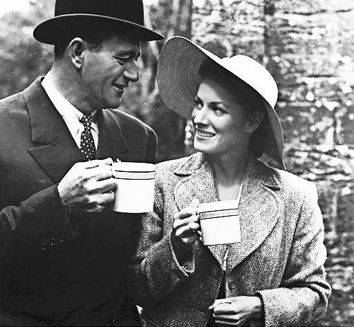 John Wayne and Maureen OHara sharing a cup on the set of The Quiet Man.