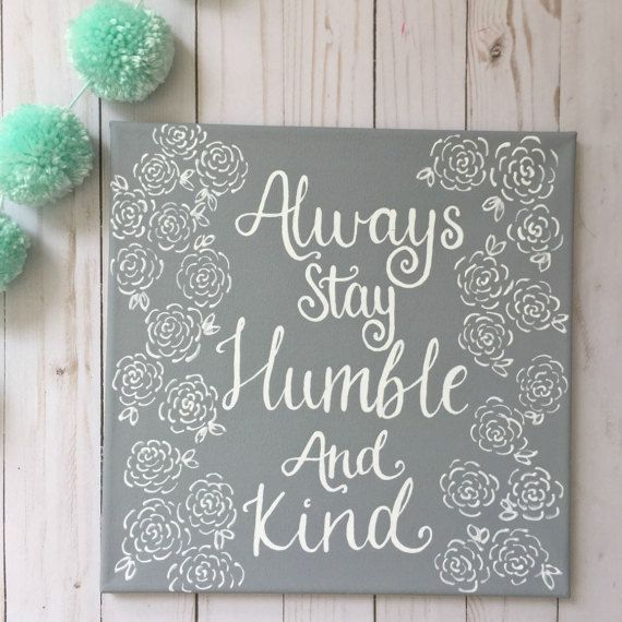 Always stay humble and kind with this hand painted home decor item! This painting is 12x12 inches with a gray background with white lettering and flower pattern. This quote from the song by Tim McGraw is sure to melt your heart and brighten your home! This hand painted piece would make the perfect gift for any country music fan!  This item is made to order and fully customizable! Prefer a different color background? Or different color lettering? Just leave a note in the Note to Seller…