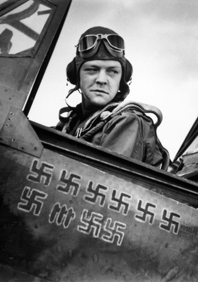 An American pilot and his kill count. Tunisia, 1943. Robert Capa