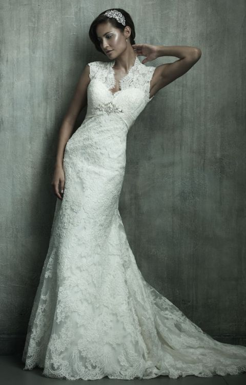 Allure Bridal- C115: This gown is a true work of art, constructed from an elegant all over lace. The romantic silhouette features a V-shaped, lace neckline with cap sleeves and a keyhole back.