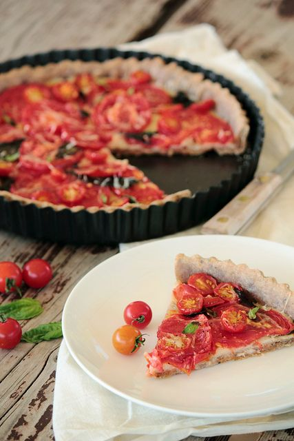 This Garden Tomato and Basil Tart truly does taste fresh from the garden. A whole wheat crust is infused with olive oil and dried basil. On top are layers of Gruyere cheese, fresh basil, and garden ripe tomatoes. The whole tart is then sprinkled with freshly ground pepper and sea salt before roasting in the oven.