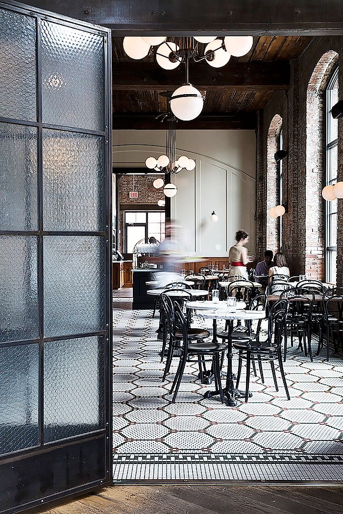 Do you have beautiful moldings, brick walls, or wooden beams? Play these original features to your advantage like at the Wythe Hotel's Reynard restaurant. Especially in a dining room where walls can feel a little bare, the more texture the better.