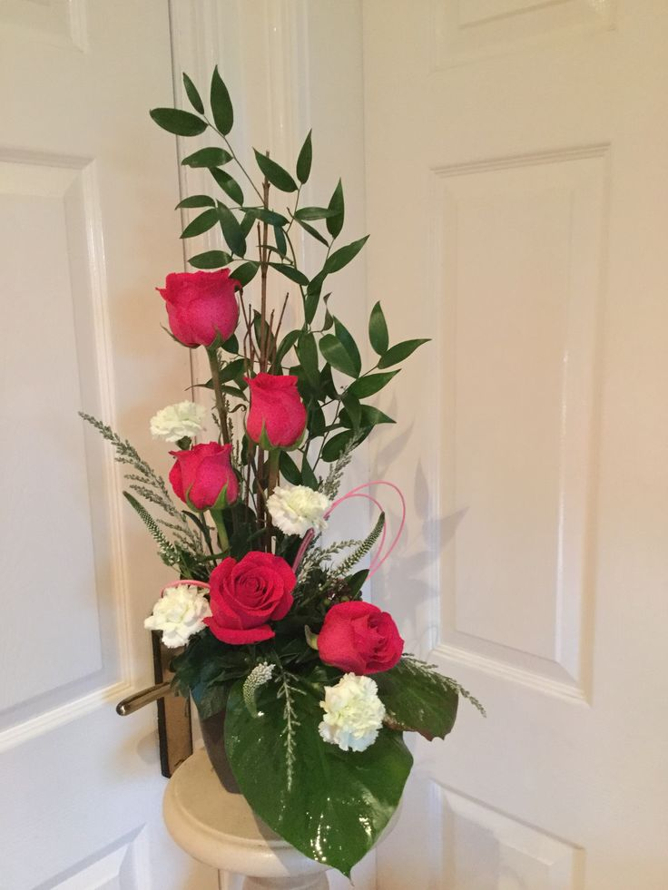 Roses, carnations and ruscus.