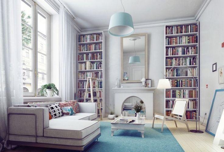 belle bibliothèque moderne et blanche encastrée dans le mur des deux côtés de la cheminée décorative blanche