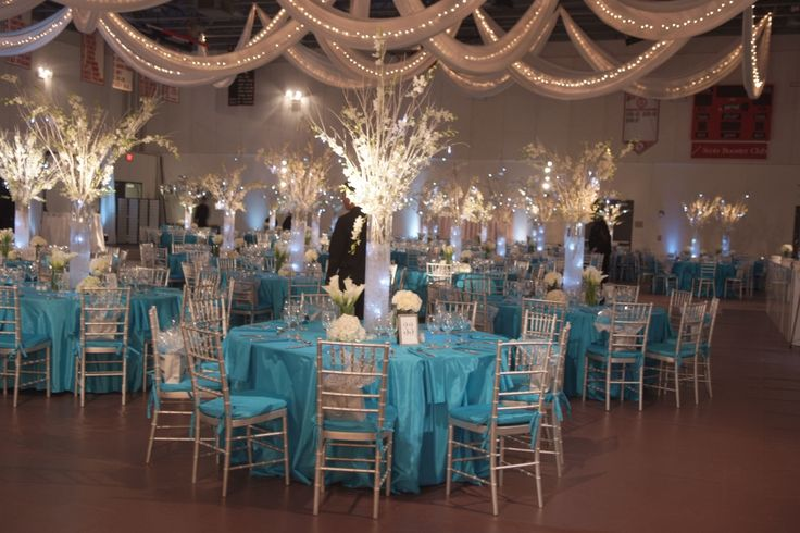 Incredible centerpieces and tables done for a school auction, #winterwonderland themed event. #wedding #partytheme