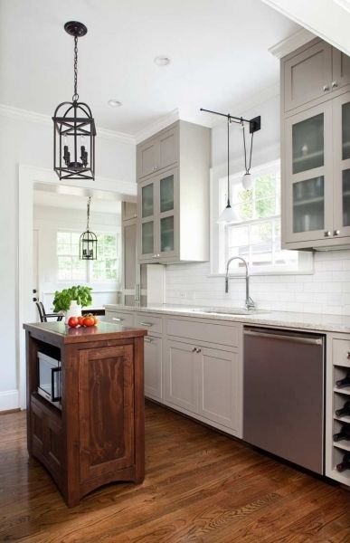 Wood floor and white kitchen.