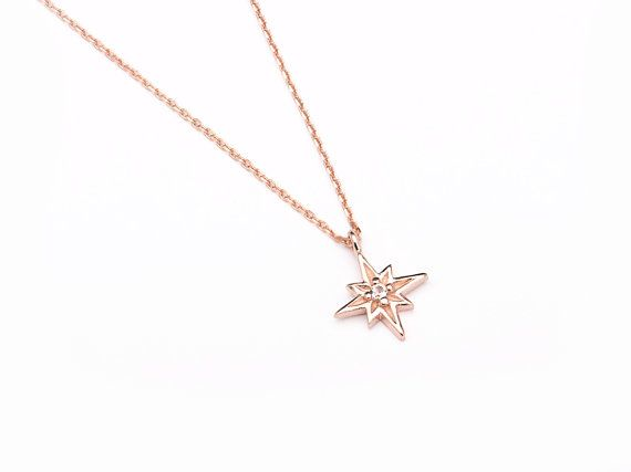 North Star Charm Necklace!  A thin sterling silver chain with 3 levels of adjustment featuring a beautiful North Star with a tiny 0,08 (2mm) white zirconia in the center for an extra spark!  Charm approximate size: 0,43 diameter x 0,06 thickness (11mm x 1,5mm).  A dainty minimalist necklace perfect for everyday use. Can be used with one or multiple charms, and as a single necklace or a layering necklace.  Also available in 22k rose and yellow gold plated sterling silver.  We offer 3 chain…