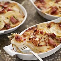 Ham and Potato Gratins: Get two meals out of one: Prepare a whole new dish using leftover ham with this easy potato, cheese, and ham casserole recipe. Dividing the gratin between ramekins makes for perfect individual main course servings.