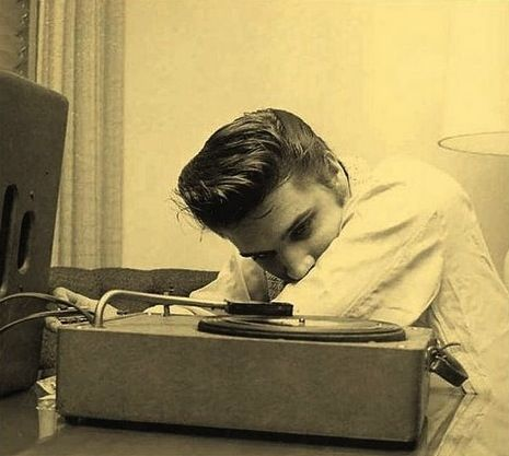 Elvis listening to music music vintage celebrity famous photo blackandwhite icon legend elvis presley